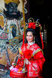 Beautiful woman with traitional chinese red dress Royalty Free Stock Photos