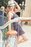 Beautiful woman travel at europe by city vintage bicycle Royalty Free Stock Photography