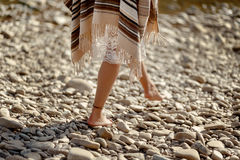 Beautiful woman traveler walking barefoot  at river beach, legs Royalty Free Stock Photography