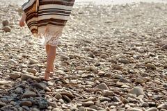 Beautiful woman traveler walking barefoot  at river beach, legs Stock Photography