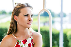 Beautiful woman travelling on a scenic railway. And enjoying herself stock photography