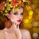 Beautiful woman with tree autmn ornament in head Royalty Free Stock Photo