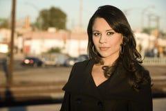 Beautiful Woman in a Trenchcoat. Beautiful woman iwearing black trenchcoat in urban setting Stock Image
