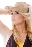 Beautiful woman in a trendy hat standing thinking Royalty Free Stock Photo