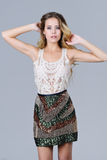 Beautiful woman in trendy sequined skirt Stock Photography