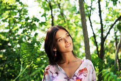 Beautiful woman in tropical forest Stock Photography