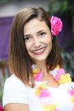 Beautiful woman on a tropical getaway. Beautiful woman wearing the welcoming floral garland and flower in her hair traditional of the hospitality on tropical Stock Images