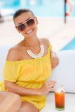 Beautiful woman on a tropical resort. Royalty Free Stock Photography