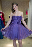 Beautiful woman try on a dress Royalty Free Stock Image