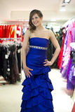 Beautiful woman try on a dress Royalty Free Stock Photography