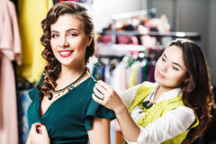 Beautiful woman trying on clothes Royalty Free Stock Photos