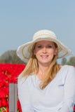 Beautiful woman in the tulip field Stock Photo