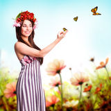 Beautiful woman with tulip hair decoration and butterflies Stock Image