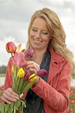 Beautiful woman with tulips Stock Images