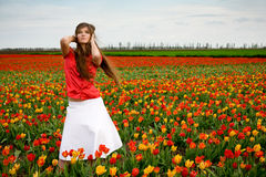 Beautiful woman in tulips field Stock Image