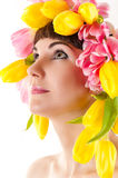 Beautiful woman with tulips on the head Stock Photos