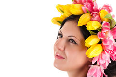 Beautiful woman with tulips on the head looking up Royalty Free Stock Photography