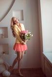 Beautiful woman with tulips Stock Photos