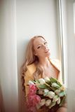 Beautiful woman with tulips Royalty Free Stock Photo