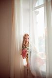 Beautiful woman with tulips Stock Image