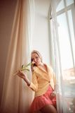 Beautiful woman with tulips Stock Image