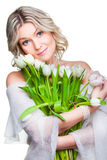 Beautiful woman with tulips on isolated white Royalty Free Stock Photography
