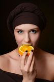 Beautiful woman in a turban with a creative make-up Stock Photo