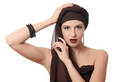 Beautiful woman in a turban with a creative make-up Stock Photography