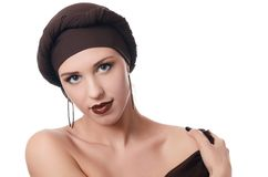 Beautiful woman in a turban with a creative make-up Stock Photos