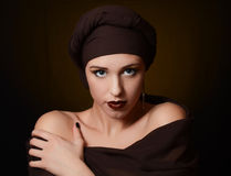 Beautiful woman in a turban with a creative make-up Royalty Free Stock Photo