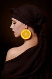 Beautiful woman in a turban with a creative make-up Stock Image