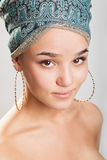 Beautiful woman in a turban. Sexy girl with bare shoulders in a turban Royalty Free Stock Photo
