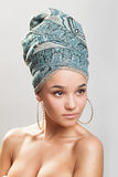 Beautiful woman in a turban. Sexy girl with bare shoulders in a turban Royalty Free Stock Images