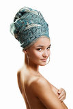Beautiful woman in a turban. Sexy girl with bare shoulders in a turban Stock Photography