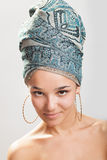 Beautiful woman in a turban Stock Images