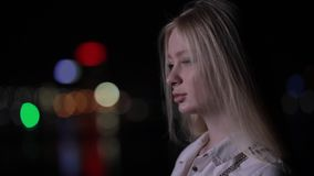 Beautiful woman turn face in night city looking at camera stock footage