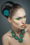Beautiful woman with turquoise jewelry. Beautiful elegant woman with turquoise jewelry Stock Photography
