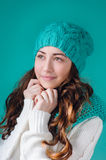 Beautiful woman in a turquoise knitted cap Stock Image