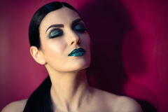 Beautiful woman with turquoise makeup royalty free stock photography