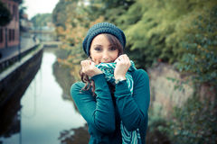 Beautiful woman with turtleneck in the city Stock Images