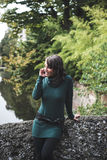 Beautiful woman with turtleneck on the phone in the city Royalty Free Stock Image