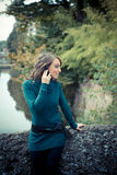 Beautiful woman with turtleneck on the phone in the city Royalty Free Stock Photos