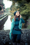 Beautiful woman with turtleneck on the phone in the city Stock Photos