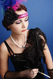 Beautiful woman in twenties style Stock Images