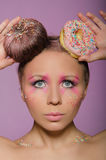 Beautiful woman with two donuts on head Royalty Free Stock Images