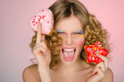 Beautiful woman with two donuts Royalty Free Stock Images