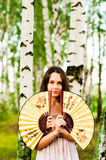 Beautiful woman with two fans. Beautiful woman having covered two fans Royalty Free Stock Images