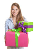 Beautiful woman with two gifts for christmas Stock Image