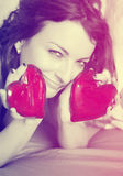 Beautiful woman with two red hearts, vintage filter Stock Image