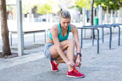 A beautiful woman tying her shoelaces Royalty Free Stock Photo